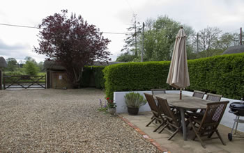 Enford House self catering cottage has a lovely south facing terrace with a barbeque