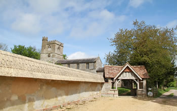 Enford House cottage is next to Enford Church which is and 18th century church with a   litchgate entrance